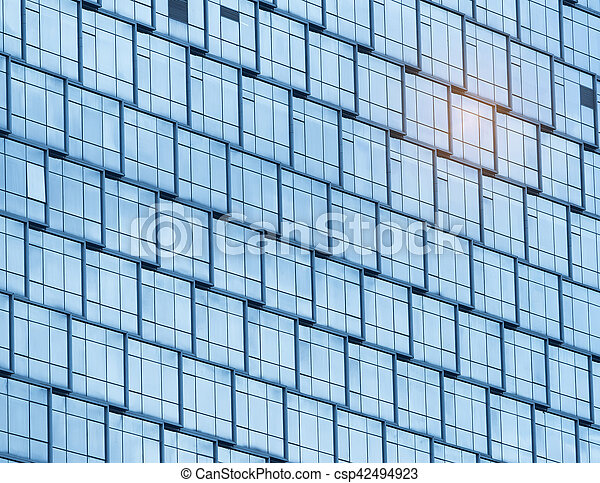Contemporary office building blue glass wall detail - csp42494923