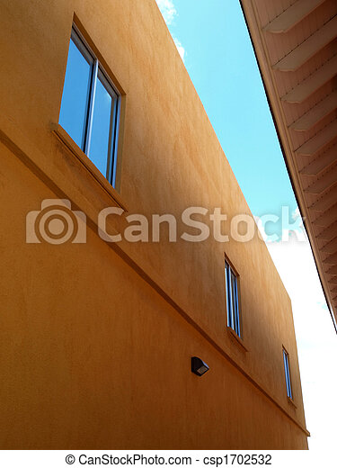 Contemporary two story stucco building and windows - csp1702532