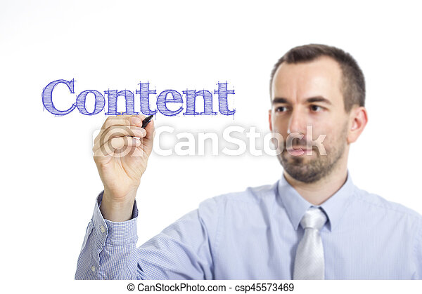 Content - Young businessman writing blue text on transparent surface - csp45573469