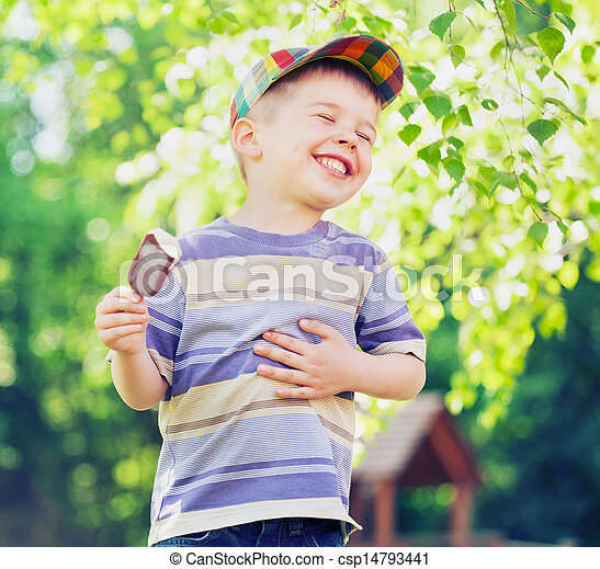 Contented small boy eating an ice cream - csp14793441