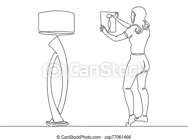 Continuous single drawn one line designer girl shoots on a tablet floor lamp - csp77061466