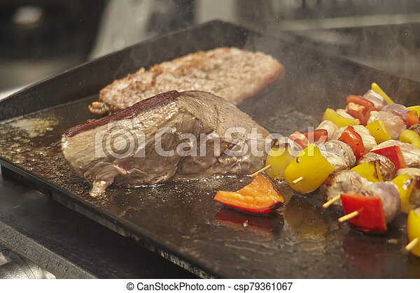 Cook the meat on the plate - csp79361067