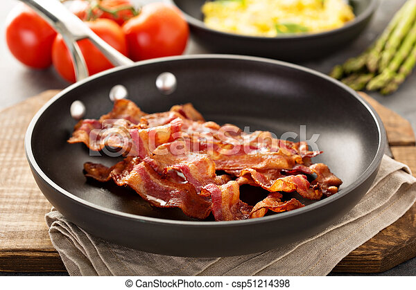 Cooked bacon on a skillet - csp51214398