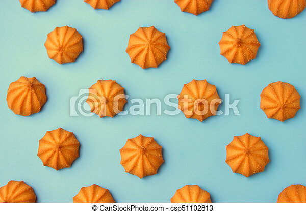 cookies on blue background. Top view. - csp51102813