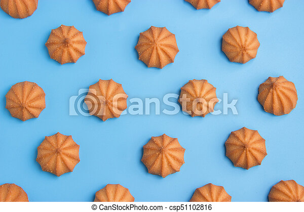 cookies on blue background. Top view. - csp51102816