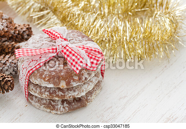 cookies on white wooden background - csp33047185