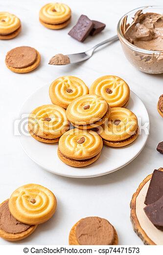 cookies with chocolate cream - csp74471573