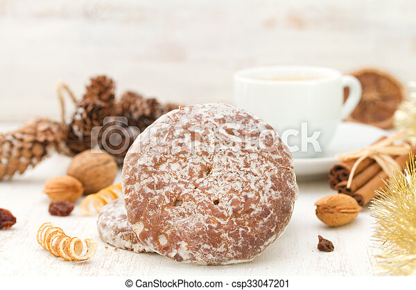 cookies with cup of coffee on white wooden background - csp33047201