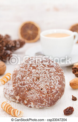 cookies with cup of coffee on white wooden background - csp33047204