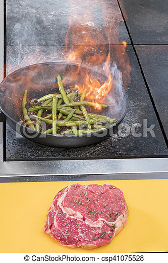 Cooking asparagus in a frying pan - csp41075528