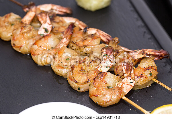 cooking shrimp on the grill  - csp14931713
