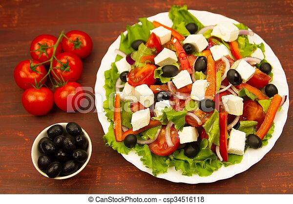 cooking summer Greek salad on wooden background - csp34516118