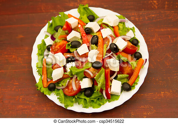 cooking summer Greek salad on wooden background - csp34515622