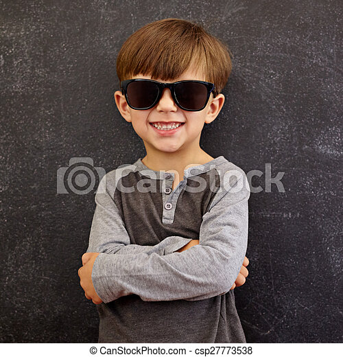 4e9f2258585a Cool boy in sunglasses. Photo of adorable young happy boy looking at ...