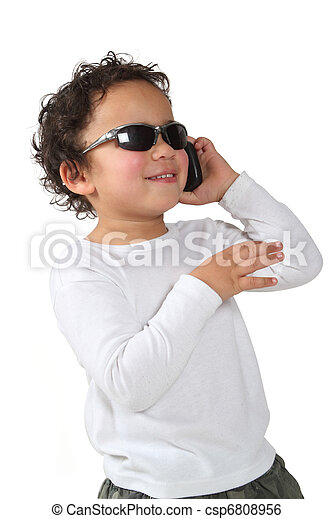 577f9c860273 Cool kid on a cell phone with sunglasses on a white background.