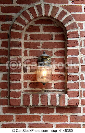 Copper lantern in brick wall - csp14146380