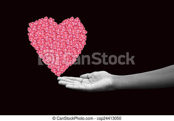 Corazón, hecho, tenencia, y, rosas, negro, manos humanas ...