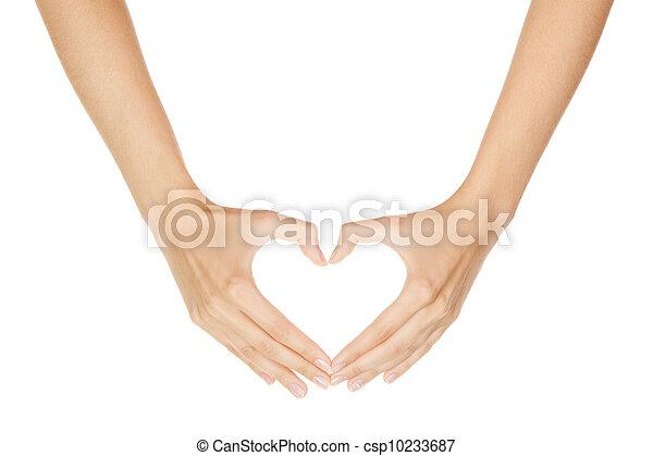 Una mujer haciendo señales de corazón aislado en el fondo blanco - csp10233687