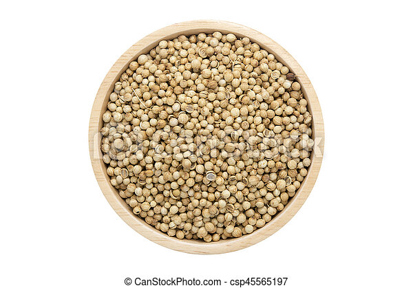 coriander seeds in wooden bowl isolated top view on white - csp45565197