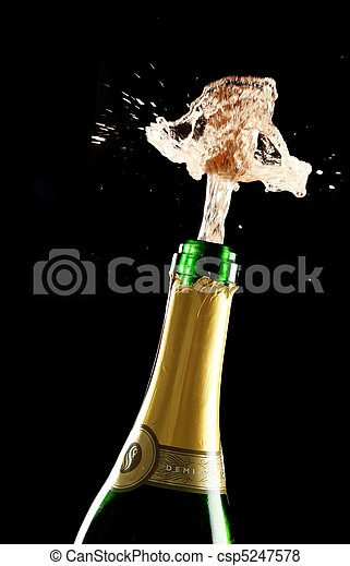 Cork Exploding Out Champagne Bottle - csp5247578