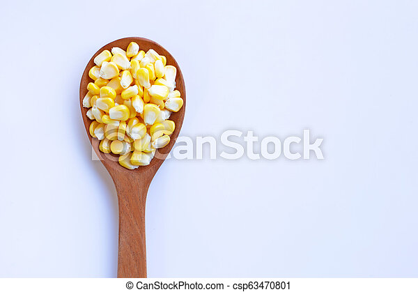 Corn seeds on wooden spoon, white background - csp63470801