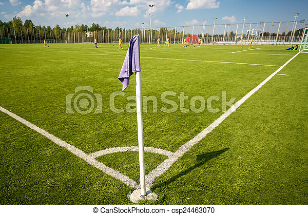 corner flag on soccer field at sunny day - csp24463070