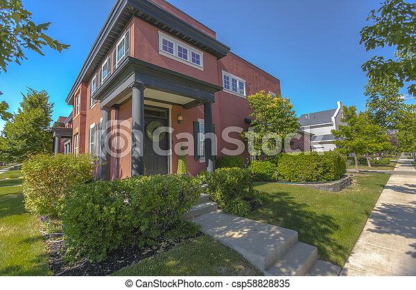 Corner home in public area with sidewalks - csp58828835