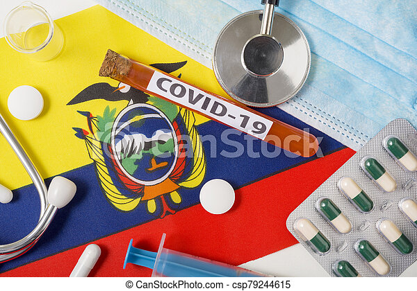 Coronavirus, the concept COVid-19. Top view protective breathing mask, stethoscope, syringe, tablets on the flag of Ecuador. - csp79244615