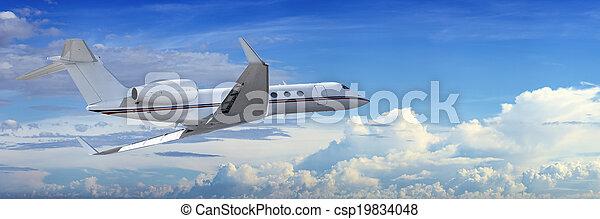 Corporate jet cruising in a cloudy sky - csp19834048