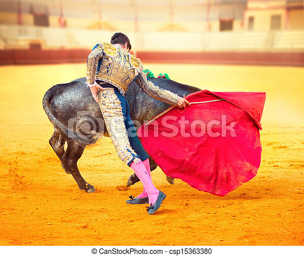 Corrida. Matador Fighting in a typical Spanish Bullfight  - csp15363380