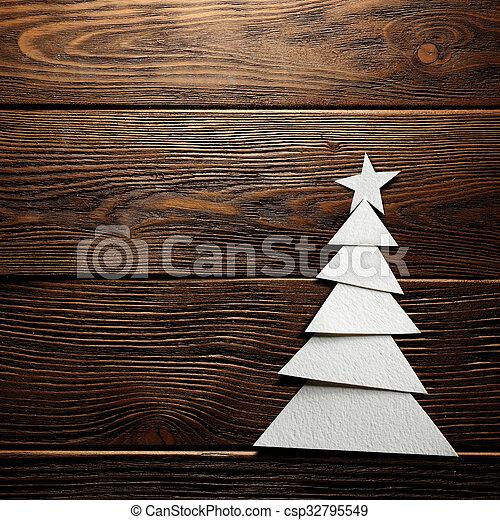 Árbol de Navidad cortado de papel en el fondo - csp32795549