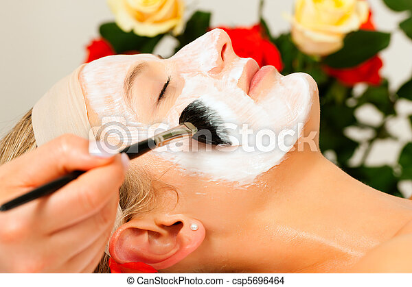 Cosmetics and Beauty - applying facial mask - csp5696464