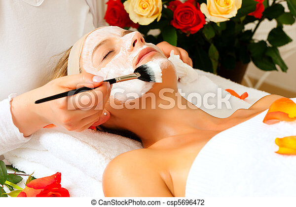 Cosmetics and Beauty - applying facial mask - csp5696472