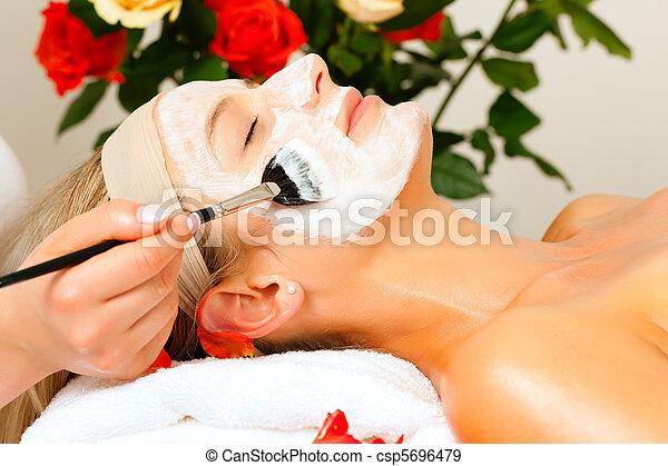 Cosmetics and Beauty - applying facial mask - csp5696479