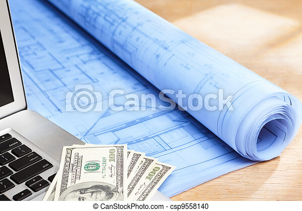 Cost of house design blueprint of house design on wooden stock cost of house design stock photo malvernweather Gallery