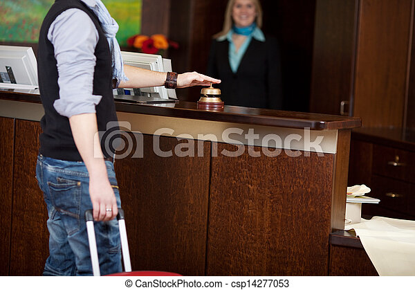costumer ringing bell at hotel counter - csp14277053