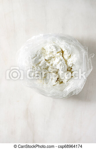Cottage cheese in plastic bag - csp68964174