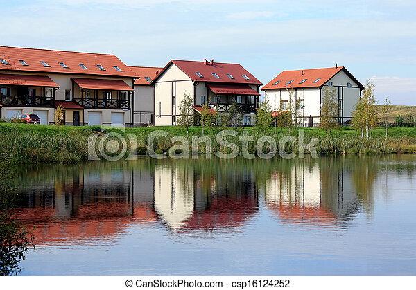 cottage village on the lake - csp16124252