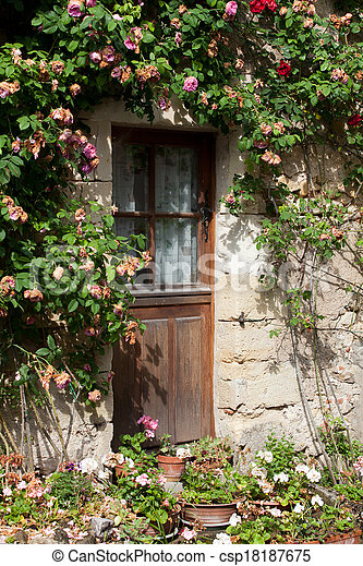cottage with roses around door  - csp18187675