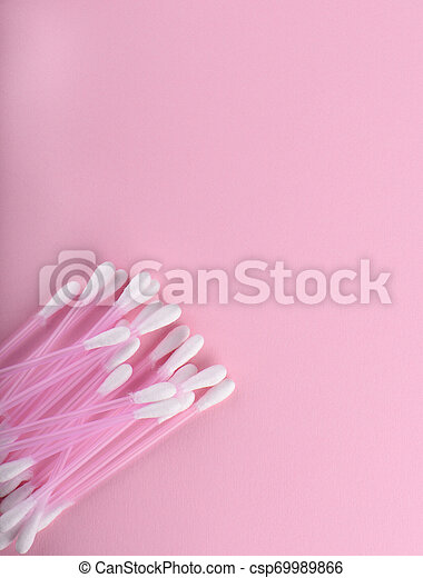 Cotton buds over a pink background. Hygienic supplies. - csp69989866