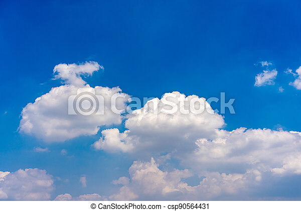 Cotton like white clouds on blue sky background - csp90564431