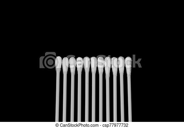 Cotton sticks isolated on the black background - csp77977732
