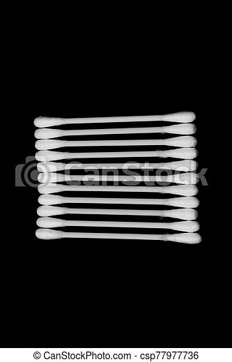 Cotton sticks isolated on the black background - csp77977736