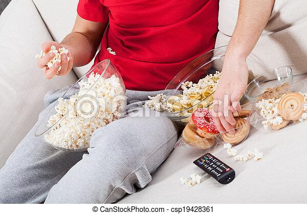 Couch potato watching tv - csp19428361