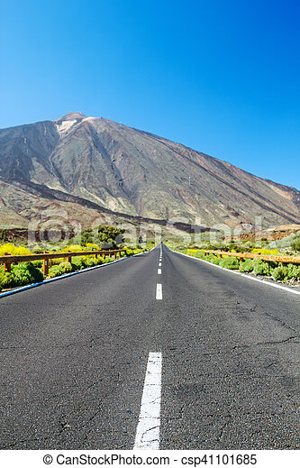 Country asphalt road background with focus on foreground and blurred landscape. - csp41101685