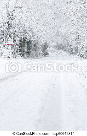 Country lane in snow - csp60648314