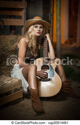 Country look girl with guitar. Attractive woman with country look ... 6308e7f06b4e