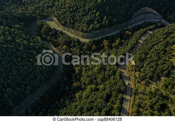 Country road in the shape of an M - csp88406128