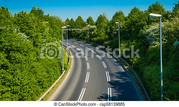 country road with trees beside. Asphalt road - csp58139885