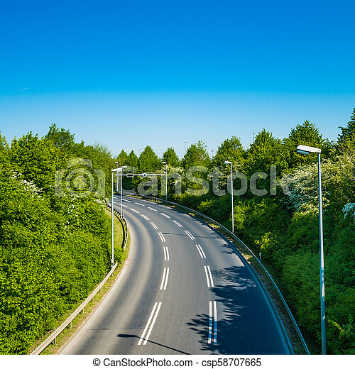 country road with trees beside. Asphalt road - csp58707665